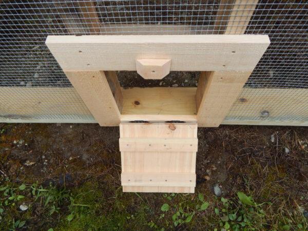 12x12 JCS Built Chicken Door with Ramp Down on 8x8 Chicken Coop. Exterior view.
