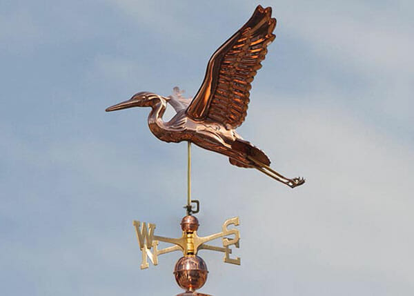 This flying blue heron weathervane is made out of copper with brass directionals.