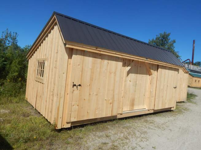 Heavy Duty Drop Latch made of Steel and powder coated black.  Installed on sliding barn doors on 12x20 Three Sled Shed.