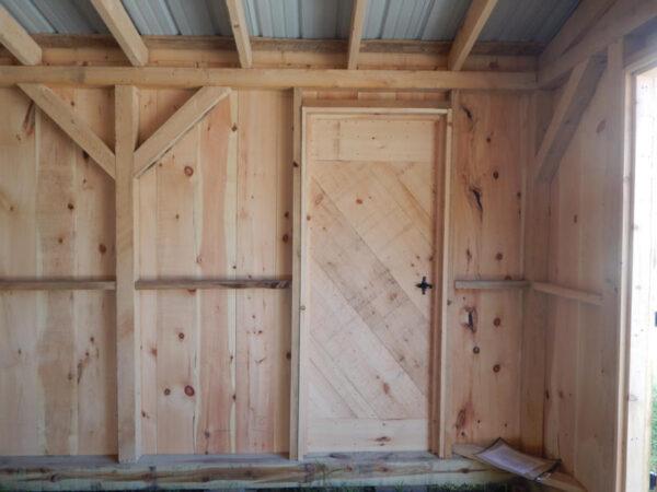 "2-8 JCS Built 2"" Thick Pine Single Door on 14x20 Barn Garage. Interior view. Black Turn Latch."