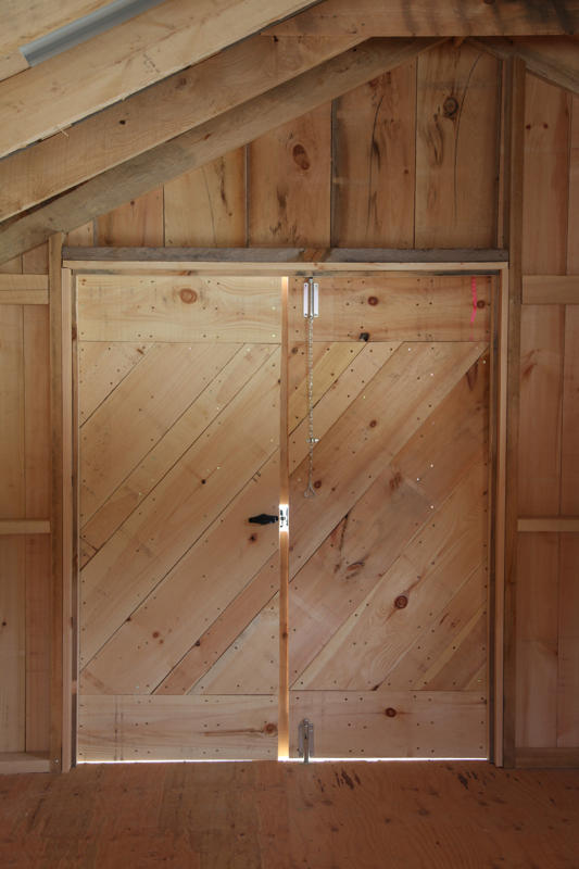 The inteiror of our shed doors have a diaganol design to strengthen the construction of these rough sawn pine doors.