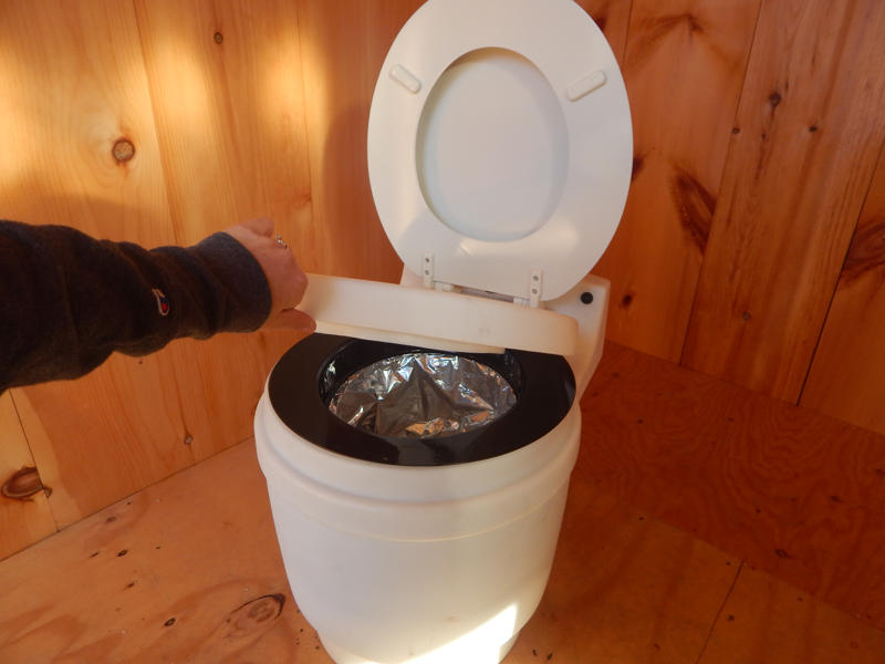 Laveo Dry Flush Toilet seat.  Self contained, compact & odorless. For use in Tiny House, cabin, camp or RV.