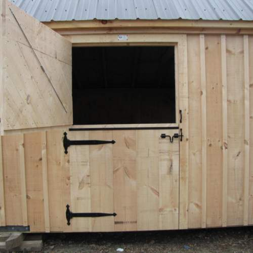 "4-0 JCS Built 2"" thick Pine Dutch Door on 10x20 Two Stall Barn.  Exterior view. Black Drop Latch and Strap Hinges."