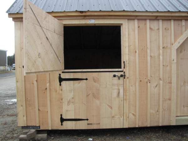 """4-0 JCS Built 2"""" thick Pine Dutch Door on 10x20 Two Stall Barn.  Exterior view. Black Drop Latch and Strap Hinges."""