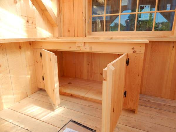This pine cabinet doubles as storage and a workbench or counter.
