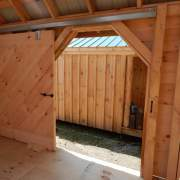 "5' JCS Built 2"" thick Pine Sliding Barn Door.  Interior view with track.  Black Drop latch."