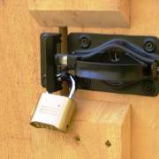 Steel door handle finished with black, satin enamel.  Turn latch adjustable to most door thicknesses.  Shown with Padlock.