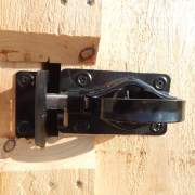 The Whitcomb Door Latch is the most popular door hardware for our double doors. A padlock can be used to secure the door from intruders.