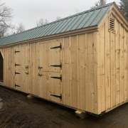 """4-0 JCS Built 2"""" thick Pine Dutch Door on 10x30 Three Stall Barn. Exterior view. Black Drop Latch and Strap Hinges."""