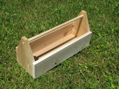 A dowel handle is built into this cedar toolbox.