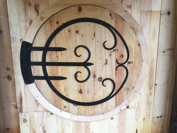 """6' Round 2"""" Thick JCS Built Circular Door with custom forged wrought iron hinges."""