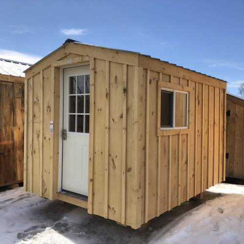 8x10 Insulated Bunkie Cottage with hinged windows and board-and-batten siding