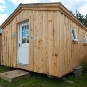 Small cabin with an insulated door and two awning windows