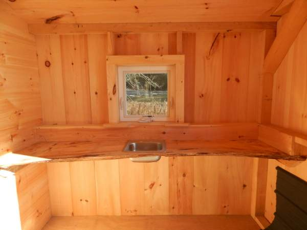 Small cabin with a built in live-edge countertop