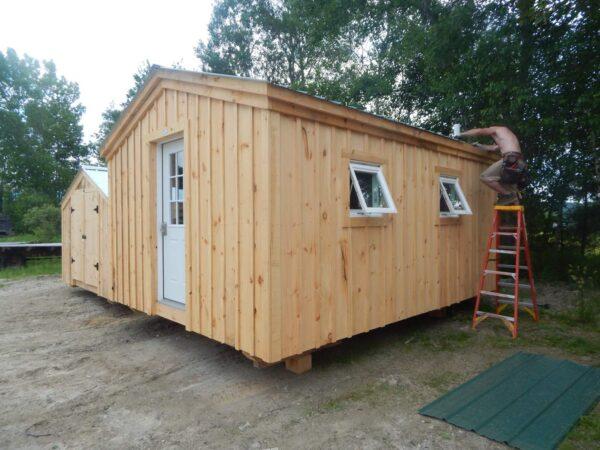 A simple prefab mini cabin with insulated windows.