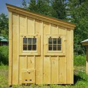A minimalist shed roof buidling constructed out of pine and hemlock.