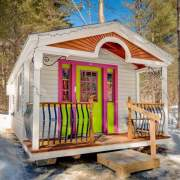 12x16 Apple Blossom Cottage with white painted novelty pine siding and decorate porch railing