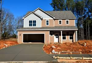 Featured alt: A house with a garage.