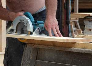 Employee working with a circular saw