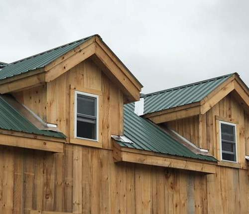 Two Dog House Dormers installed on a Vermont Cabin