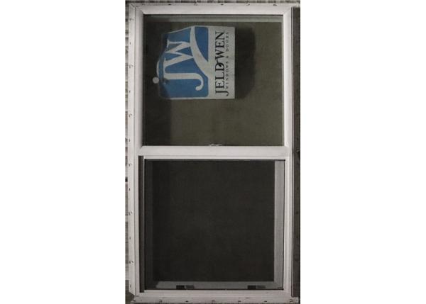"""32-57"""" Insulated Double-Hung Window with adjustable bottom panel. Jeldwen Windows & Doors."""