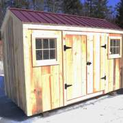 6x12 Economy Nantucket with barn-sash windows and a red corrugated metal roof