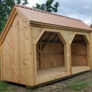 6x16 Woodbin firewood storage shed with a roof upgrade.