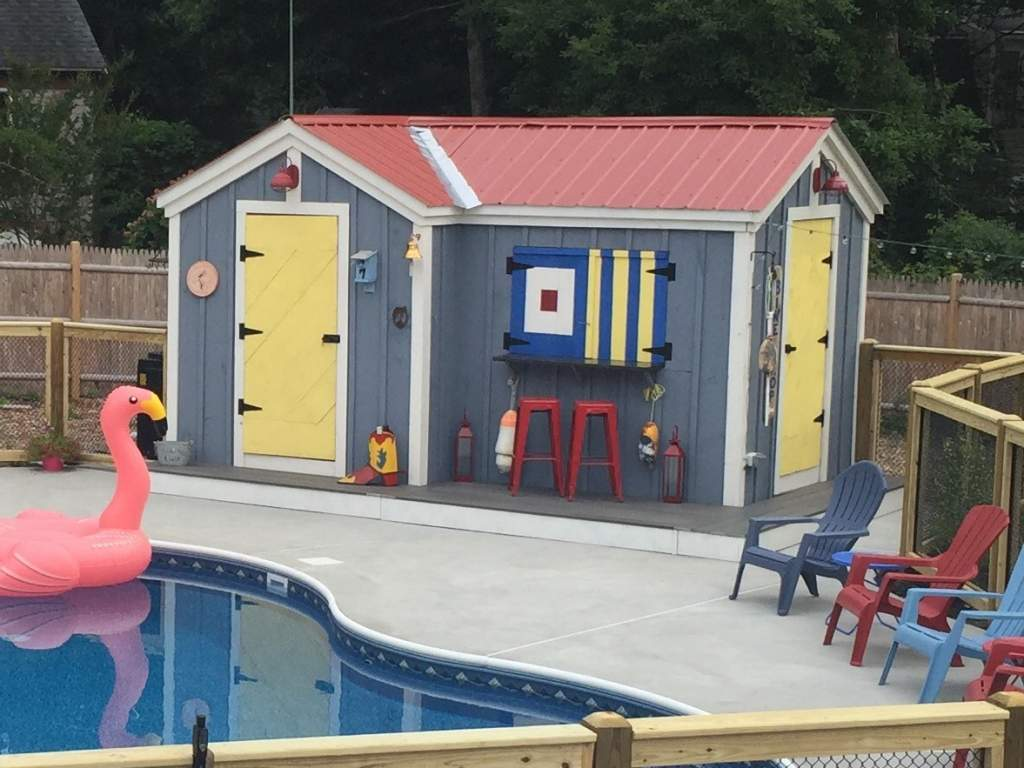 Painting a storage shed with vibrant hues will create a festive, summer atmosphere.