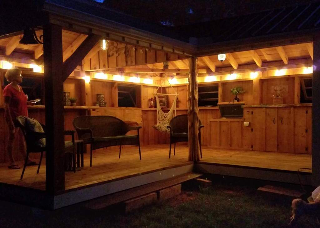 This prefab storage shed was converted into a backyard bar with some creative design choices.