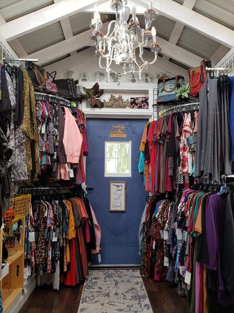 This 8x16 Garden Shed was converted into a tiny store that sells vintage clothing.