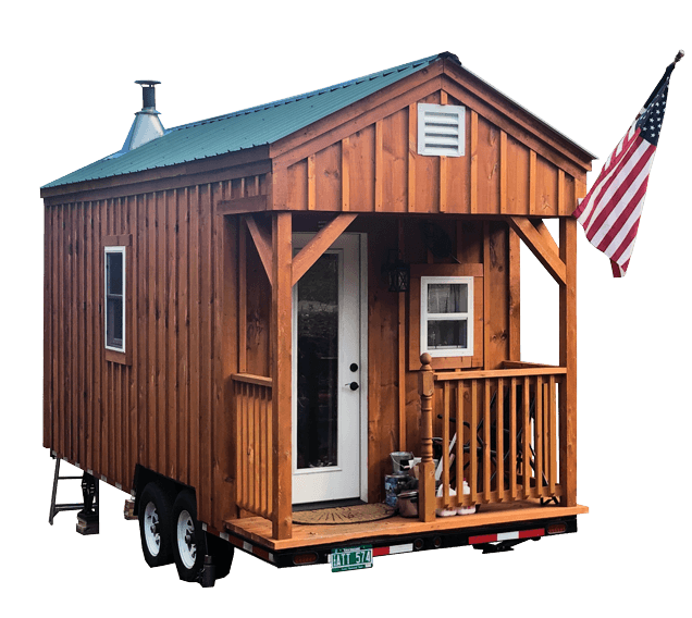 Jamaica Cottage Shop Tiny House on Wheels with a green roof and decorative American flag