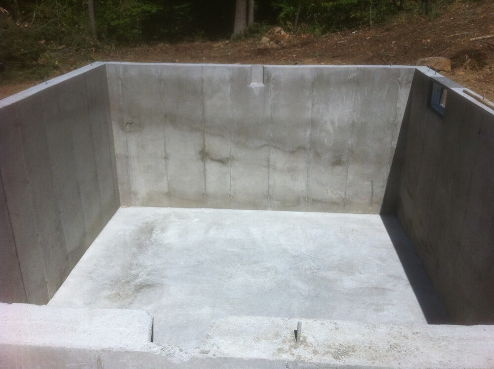 Full concrete foundation with small windows.