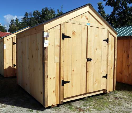 8x8 Economy Vermonter with Pine Board Siding and Black Corrugated Metal Roofing